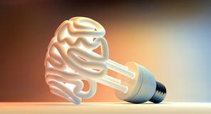 Brain Flourescent Light Bulb. An illuminated fluorescent light bulb in the shape of a stylized brain on an  colorful studio background Royalty Free Stock Images