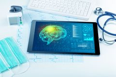 Diagnostics on tablet with brain functionality concept. Brain functionality report with medical devices aroundn royalty free stock images
