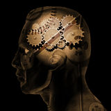 Brain Gears. Image of various gears inside of a man's head on a black background stock illustration