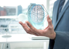 Brain with hexagon graphic in the hand of a business man Stock Photo
