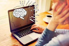 Brain illustration with man using a laptop stock photography