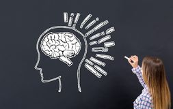 Brain illustration with young woman. Writing on a blackboard stock photo