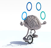 Brain juggle with arms and legs rides a unicycle Stock Photography