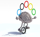 Brain juggle with arms and legs rides a unicycle Stock Image