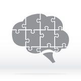 Brain Logo-Schattenbild im Grau Gehirn in Form eines Puzzlespiels Lizenzfreie Stockfotografie