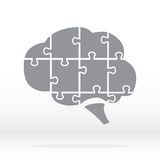 Brain Logo silhouette in grey. Brain in the form of a puzzle. Stock . Flat design Royalty Free Stock Photography