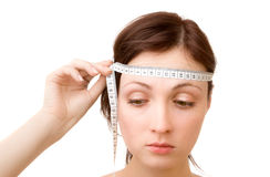 Brain measuring. Young woman - measuring brain size (isolated on white Royalty Free Stock Photo