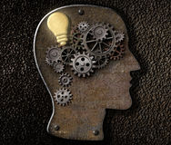 Brain mechanism made from metal cogs and gear with idea bulb royalty free illustration