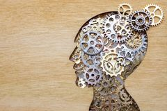 Brain model concept made from gears and cogwheels on wooden background. Brain model concept made from gears and cogwheels in wooden plate stock image