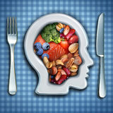Brain Nutrition. And brainpower food diet as fish and nuts with broccoli and beans in a dish shaped as a human head as a healthy mind diet symbol with 3D Royalty Free Stock Image