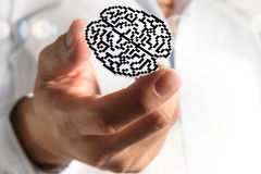 Brain pixel icon sign. Business man hand show brain pixel icon sign as medical technology Royalty Free Stock Photos