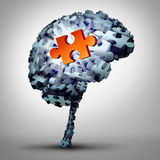 Brain Puzzle Solution. As a human mind made of jigsaw pieces with one object as a glowing red symbol of inspiration and wisdom as a 3D illustration Royalty Free Stock Image