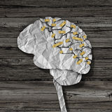 Brain Rehabilitation. And mental health therapy concept as a crumpled broken paper shaped as the human thinking organ repaired together with tape as a neurology Stock Photos