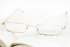 Brain Relaxation (Shallow DOF). Eyeglasses on a book pages (shallow dof Stock Image