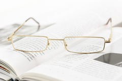 Brain Relaxation (Shallow DOF). Eyeglasses on a book pages (shallow dof Royalty Free Stock Photo