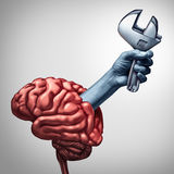 Brain Repair. Psychotherapy  or neurology surgery health care concept as a hand emerging from a human thinking organ holding a wrench as a medicine medical Stock Images