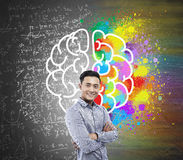 Brain sketch on blackboard and Asian man Royalty Free Stock Images