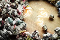 Brain storm concept with noney symbol and bulb Royalty Free Stock Photos
