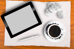 Brain storming with Blank touch pad and a cup of coffee Royalty Free Stock Images
