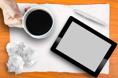Brain storming with Blank touch pad and a cup of coffee Stock Images