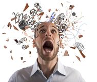Brain stressed. Stressed businessman with broken mechanism head screams Stock Photo