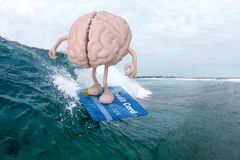 Brain surfing with credit card surfboard. Human brain with arms and legs surfing with credit card surfboard, 3d illustration Stock Photo
