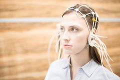 Brain test. Young woman with eeg electrodes all around her head having medical test of brain activity royalty free stock photos