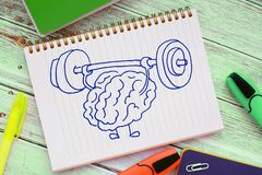 Brain training rock the muscles with a barbell. Creative idea concept