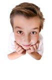 Brainiac - comical boy. Comical boy with a big head looking up.  Focus to face only Royalty Free Stock Photography