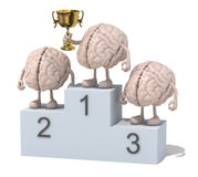 Brains with winner cup on sports victory podium Royalty Free Stock Photography