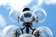 Brainstorm. Halogen city streetlights with a beautiful clear blue sky behind them Royalty Free Stock Image