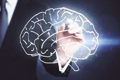 Brainstorm concept. Businessman drawing creative brain sketch. Brainstorm concept Royalty Free Stock Photos