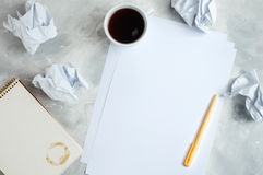 Brainstorm concept with crumpled paper, notebook and cup of coff Royalty Free Stock Photos