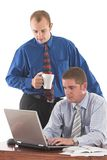Brainstorming. Two businesmen discussing work on the desk over white Stock Images