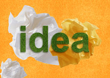 Brainstorming. Creative Thinking With Brainstorming. idea word from green grass up of Crumpled paper Stock Image