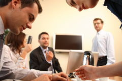 Brainstorming.Business people. Three men and two business women having brainstorming in an office stock image