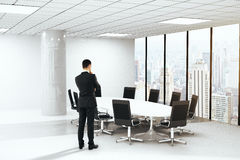 Brainstorming businessman in boardroom Stock Photos
