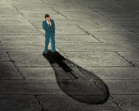 Brainstorming businessman concept. Man with his shadow in a shape of lightbulb Stock Photos
