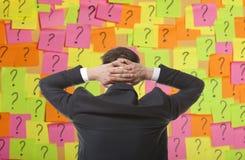 Brainstorming. Businessman solves complex problem stock image