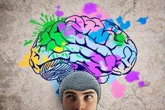 Brainstorming concept. Abstract portrait of man with robotic brain on textured background with colorful sketch. Brainstorming concept Royalty Free Stock Images