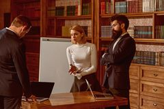 Brainstorming concept. Men and woman students hold brainstorming seminar in library. Business people have brainstorming royalty free stock image