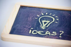 Brainstorming, funny lightbulb on blackboard Stock Photography