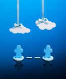 Brainstorming or Networking. Two wooden icons linked together with paper clouds overhead representing Cloud computing or a metaphor for brainstorming royalty free stock photo