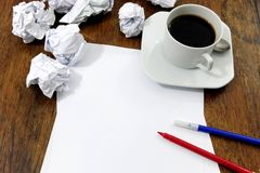 Brainstorming:  paper on desk with paperballs Stock Image