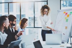 Brainstorming process at office.Young coworkers work together modern office studio.Horizontal.Blurred background.Cropped. Brainstorming process at office.Young stock photography