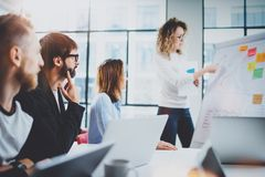Brainstorming process at office.Young coworkers working together new ideas at modern meeting room.Horizontal.Blurred. Background Stock Images