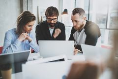 Brainstorming process at sunny office.Coworkers work together modern office studio.Happy business team making. Conversation.Horizontal.Blurred background Stock Images