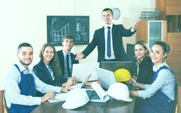 Brainstorming of professional engineers and smiling Stock Image