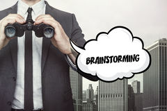 Brainstorming text on blackboard with businessman Royalty Free Stock Image