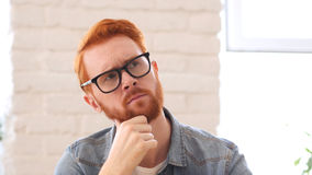 Brainstorming, Thinking Pensive Man with Beard and Red Hairs, Portrait. High quality Royalty Free Stock Image